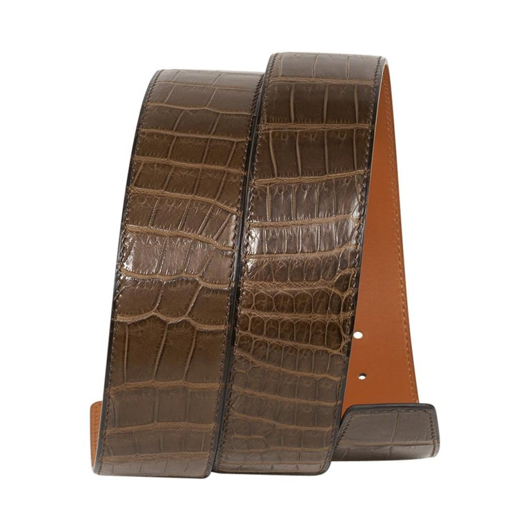 Guaranteed authentic Hermes Constance 42 mm belt featured in reversible Gris Elephant Matte Porosus Crocodile to Gold leather.  Fabulous over sized brushed Palladium signature H buckle.  Now a retired size, this is sure to become a collectors