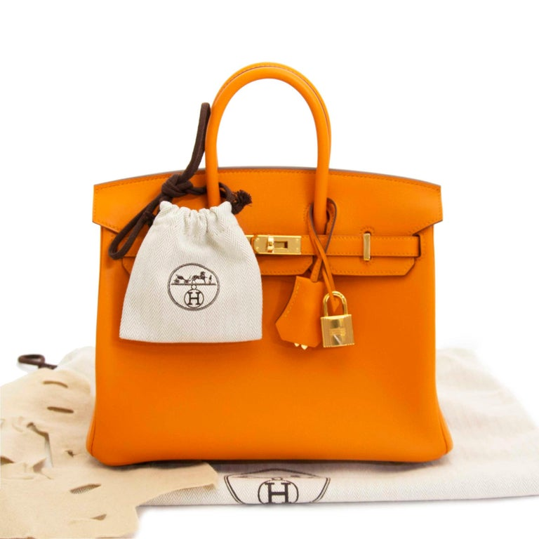 c0104f782f4d Hermès Birkin 25 Apricot Swift GHW This vibrantly colored Hermès Birkin in  the highly coveted 25