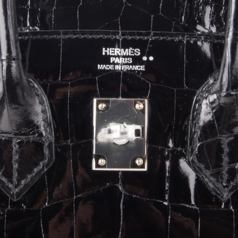 Guaranteed authentic Hermes Birkin 25 bag features classic timeless Black niloticus crocodile. Fresh with palladium hardware.  This divine jewel and easily moves from day to night. NEW or NEVER WORN   Comes with the lock and keys in the clochette,