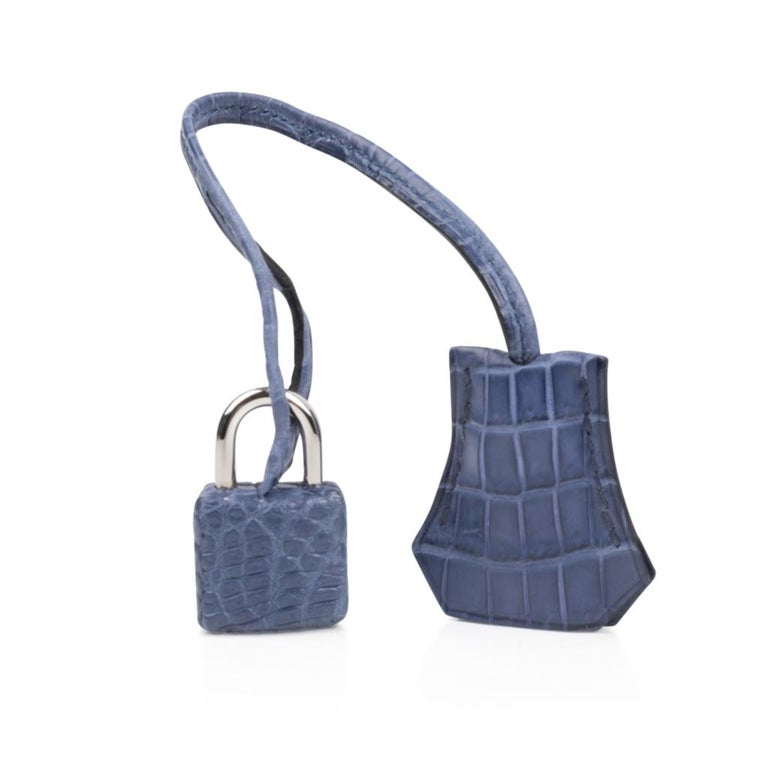 Coveted rare Blue Brighton matte crocodile Hermes Birkin 25cm bag accentuated with fresh Palladium hardware. This divine blue is neutral and easily moves from day to night. NEW or NEVER WORN   Comes with the lock and keys in the clochette, signature