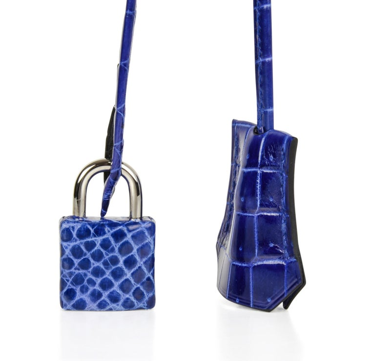 Coveted Hermes Birkin 25 bag Blue Electric crocodile accentuated with fresh Palladium hardware. This divine rich colour is like a jewel and easily moves from day to night. NEW or NEVER WORN   Comes with the lock and keys in the clochette, signature