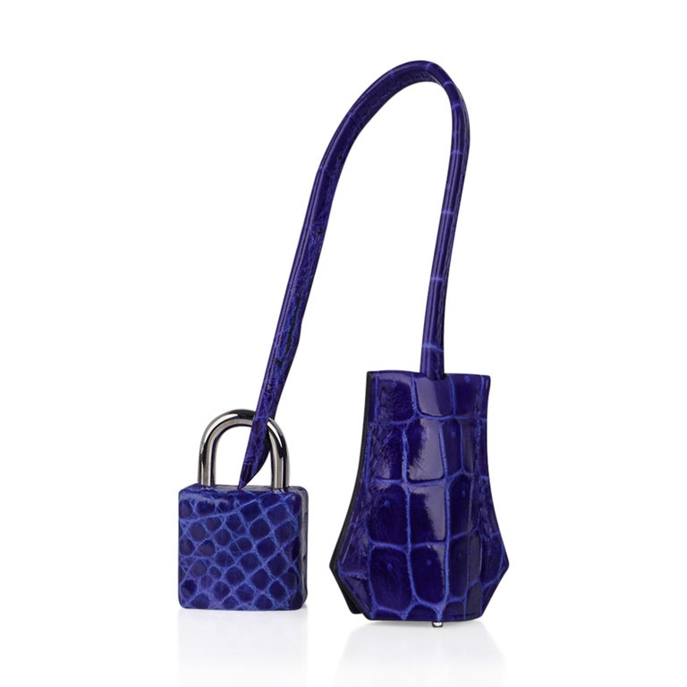 Guaranteed authentic coveted Blue Electric crocodile Hermes Birkin 25 cm bag accentuated with fresh palladium hardware. This divine rich colour Hemres Birkin bag is like a jewel and easily moves from day to night. Comes with the lock and keys in the