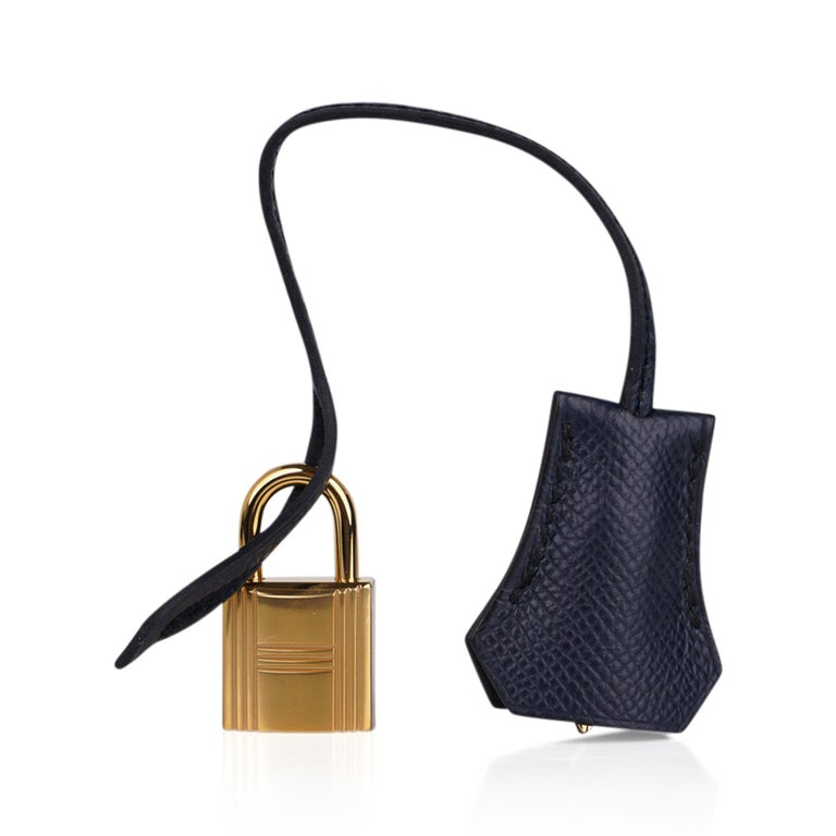 Mightychic offers a guaranteed authentic Hermes Birkin Sellier 25 bag featured in chic Blue Indigo. Richly saturated and jewel toned, Hermes Bleu Indigo is gorgeous for year round wear, and completely neutral. Lush with Gold hardware. This exquisite