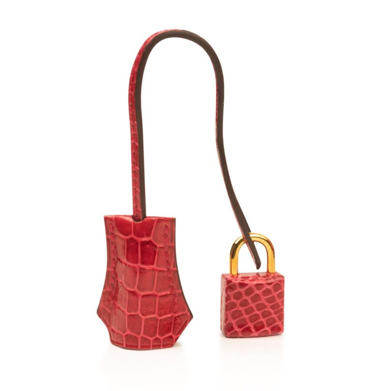 Guaranteed authentic Hermes Birkin 25cm bag coveted rare porosus crocodile Braise fire engine lipstick red.  Rarely produced this exquisite beauty is a must have for any Hermes afficionado. This Hermes Birkin is lush with gold hardware. Comes with