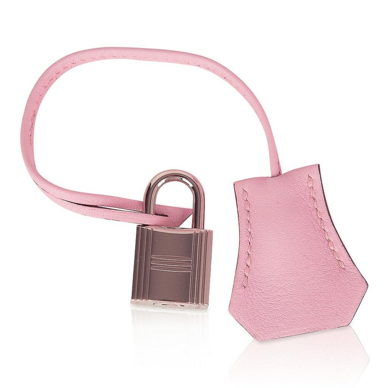 Guaranteed authentic Hermes Birkin 25 bag featured in elusive Rose Sakura. Gorgeous cherry blossom pink in swift leather.  Soft with palladium hardware. NEW or NEVER WORN   Comes with the lock and keys in the clochette, signature Hermes box, sleeper