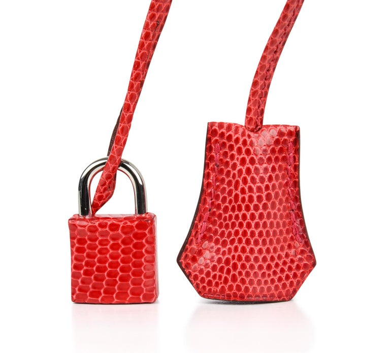 Guaranteed authentic Hermes Birkin 25 bag Rouge Exotic in rare coveted Lizard. Toned down strawberry red that is utterly neutral and striking. Fresh with palladium hardware. Comes with lock, keys, clochette, sleepers, raincoat and signature Hermes