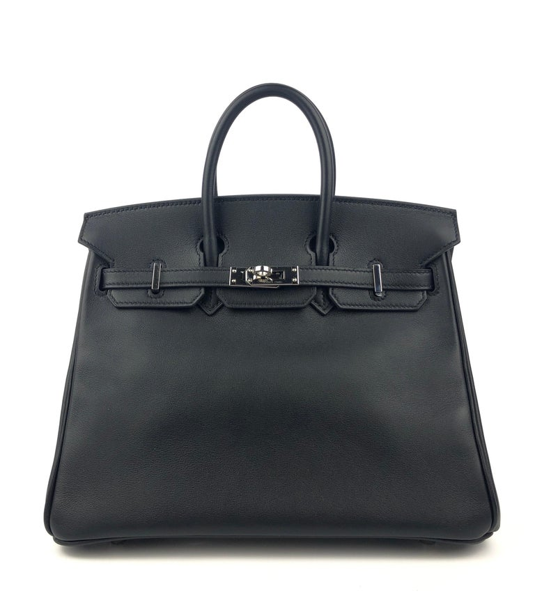 Stunning Hermes Birkin 25 Black Noir Swift Leather Palladium Hardware. Pristine Almost Like New with Plastic on Hardware and Feet. 2017 A Stamp.   Shop with Confidence from Lux Addicts. Authenticity Guaranteed!