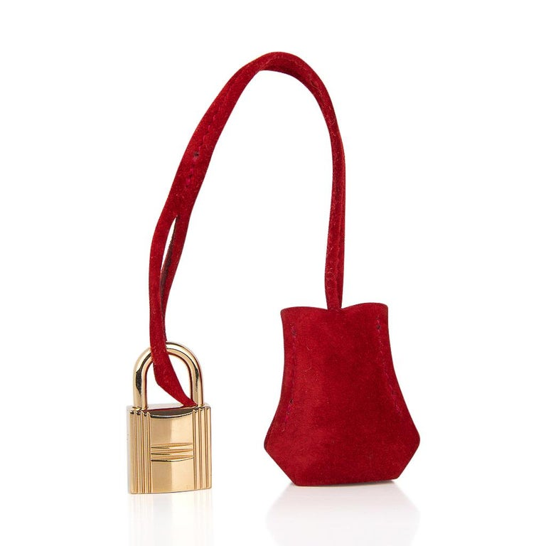 Guaranteed authentic Hermes Birkin 25 bag featured in rare Rouge VIf Doblis (Suede). This jewel toned Birkin bag is accentuated with gold hardware.  In beautiful condition with very minor light wear. Comes with lock, keys, clochette and sleeper. The