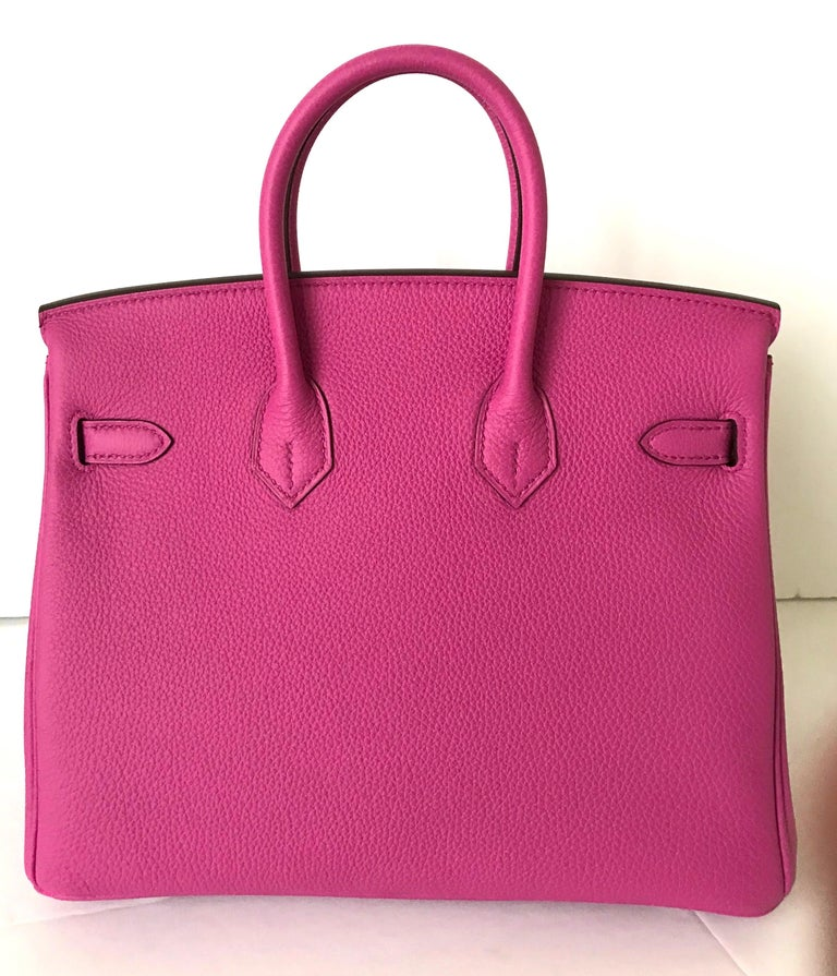 Hermes Birkin 25cm Magnolia of Togo Leather with palladium hardware.  This Birkin has tonal stitching, a front toggle closure, a clochette with lock and two keys and a double rolled handles.  The interior is lined with Chevre and has a zip with an