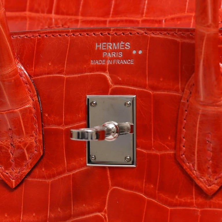 It Gets No Better Than This.  This incredible Hermes Birkin 25 bag is the ultimate status symbol for only the most discerning of Hermes collectors. Crafted of exotic crocodile skin and palladium tone hardware, this orange Poppy Hermes Birkin is in