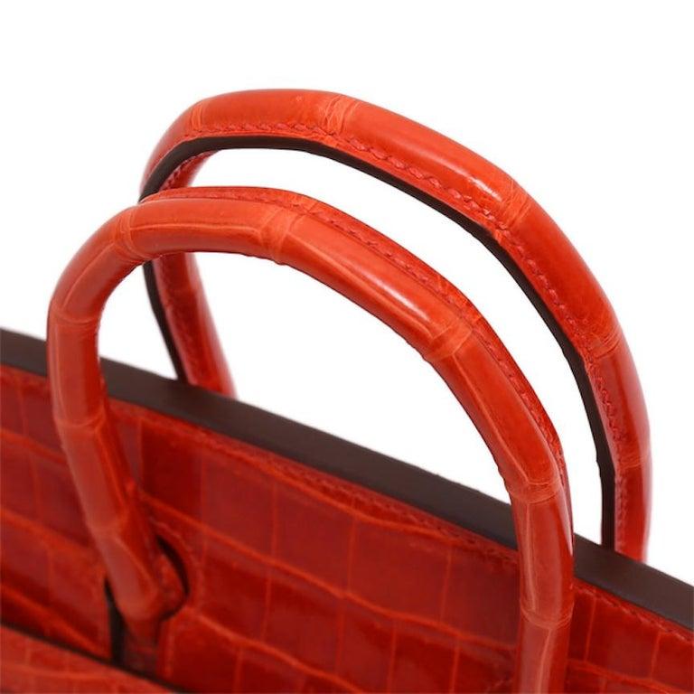 Hermes Birkin 25 Orange Crocodile Exotic Top Handle Satchel Tote Bag In Good Condition For Sale In Chicago, IL