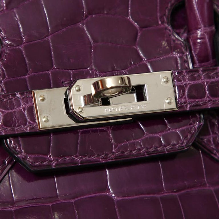 Hermes Birkin 25 Purple Crocodile Exotic Leather Top Handle Satchel Tote Bag  Crocodile Palladium plated hardware Leather lining Turn-lock closure Made in France Date code present Handle drop 3