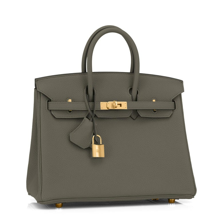 Hermes Vert Maquis Birkin 25cm Togo Gold Hardware Y Stamp, 2020 Uber chic and sleek Baby Birkin for the modern fashionista! Brand New in Box. Store Fresh. Pristine Condition (with plastic on hardware) Just purchased from Hermes store; bag bears new