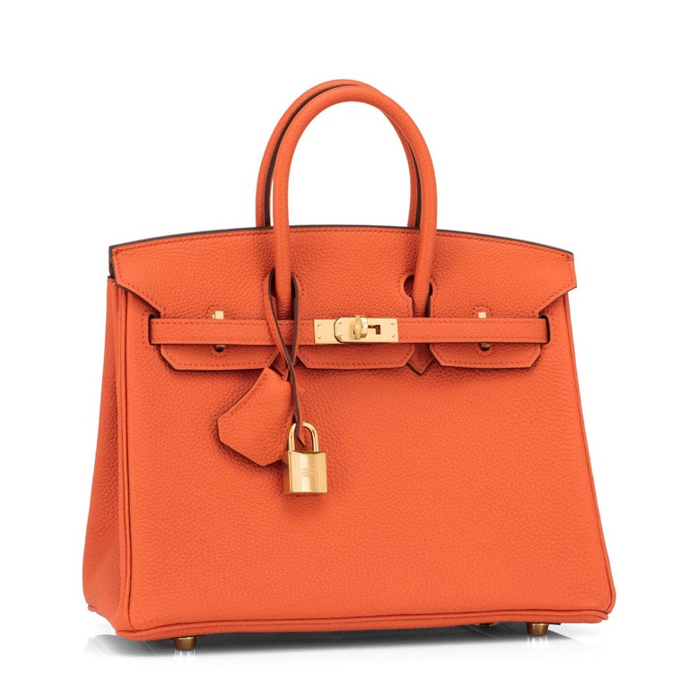 Guaranteed Authentic Hermes Classic Orange Baby Birkin 25cm Togo Gold Hardware New or Never Used. Perfect gift! Pristine Condition (with plastic on hardware) Comes full set with keys, lock, clochette, a sleeper for the bag, rain protector, and