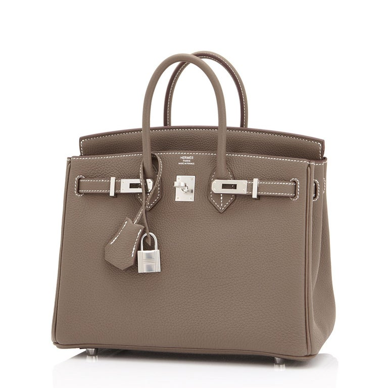 Guaranteed Authentic Hermes Etoupe Baby Birkin 25cm Togo Palladium Hardware Brand New in Box. Store Fresh. Pristine Condition (with plastic on hardware) Perfect gift! Comes full set with keys, lock, clochette, a sleeper for the bag, rain protector,