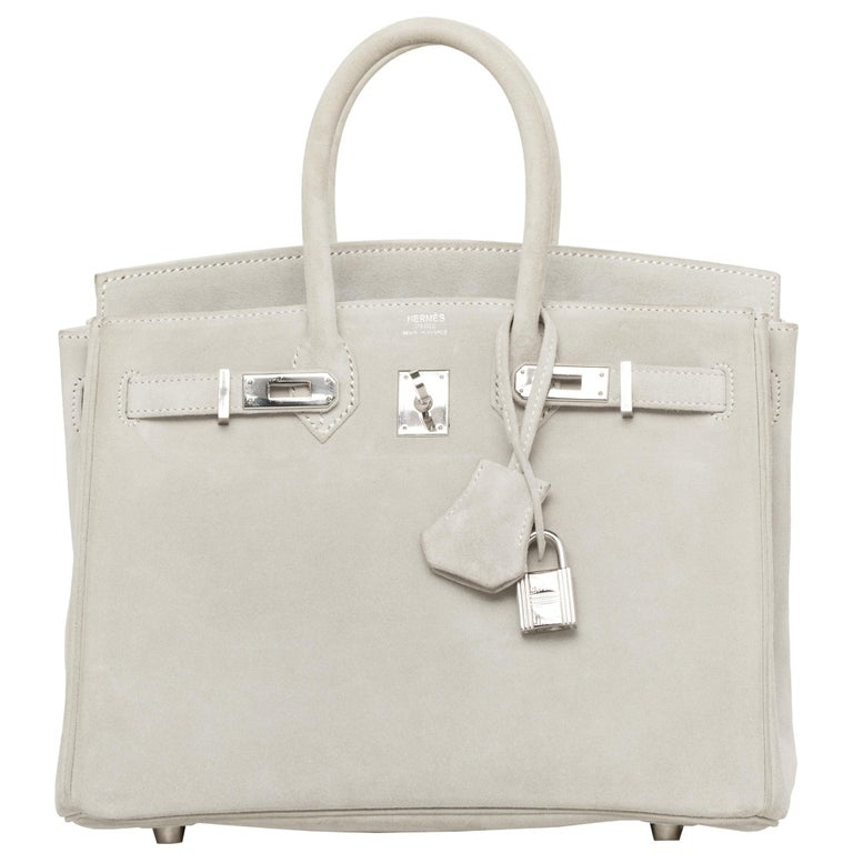 1stdibs Exclusives From Three Over Six  Brand: Hermès  Style: Birkin  Size: 25cm  Color: Gris Perle Leather: Suede Doblis Hardware: Palladium Stamp: I 2005  Condition: Vintage Mint: The item is vintage but given its age is in impeccable condition.