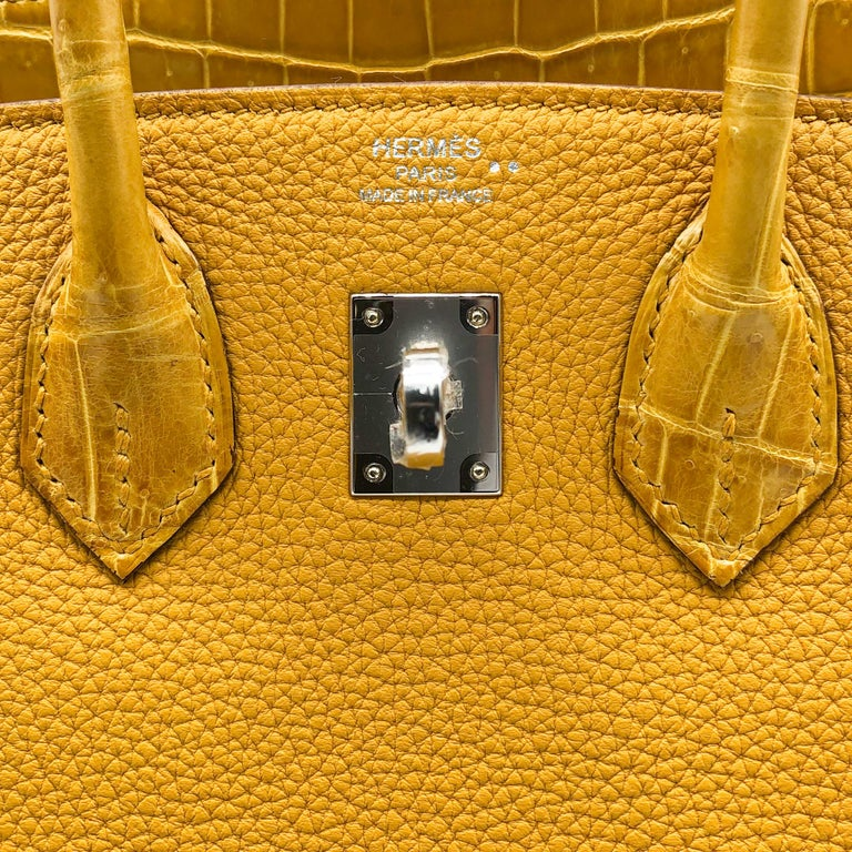 Brand: Hermès  Style: Birkin Sellier Size: 25cm Color: Jaune Ambre Leather: Shiny Niloticus Crocodile and Veau Togo Hardware: Palladium  Condition: Pristine, never carried: The item has never been carried and is in pristine condition complete with
