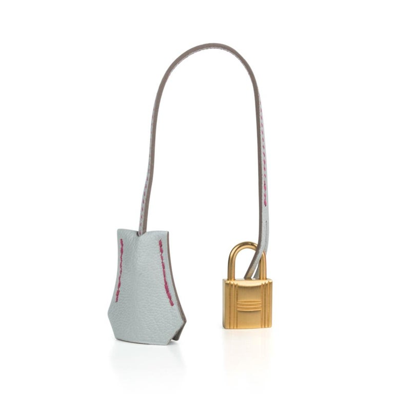 Mightychic offers a guaranteed authentic Hermes Birkin HSS 30 bag featuring coveted rare Rose Shocking and Gris Perle. Vivid pop all grown up pink with clear Gris Perle in coveted Chevre leather. This stunning special order Hermes Birkin bag is
