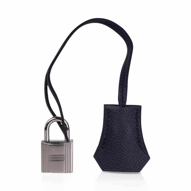 Mightychic offers a guaranteed authentic rich Hermes Birkin 30 bag featured in Bleu Indigo. Crisp with palladium hardware. Classic and timeless this beautiful Hermes bag takes you from to evening in one step. Comes with the lock and keys in the
