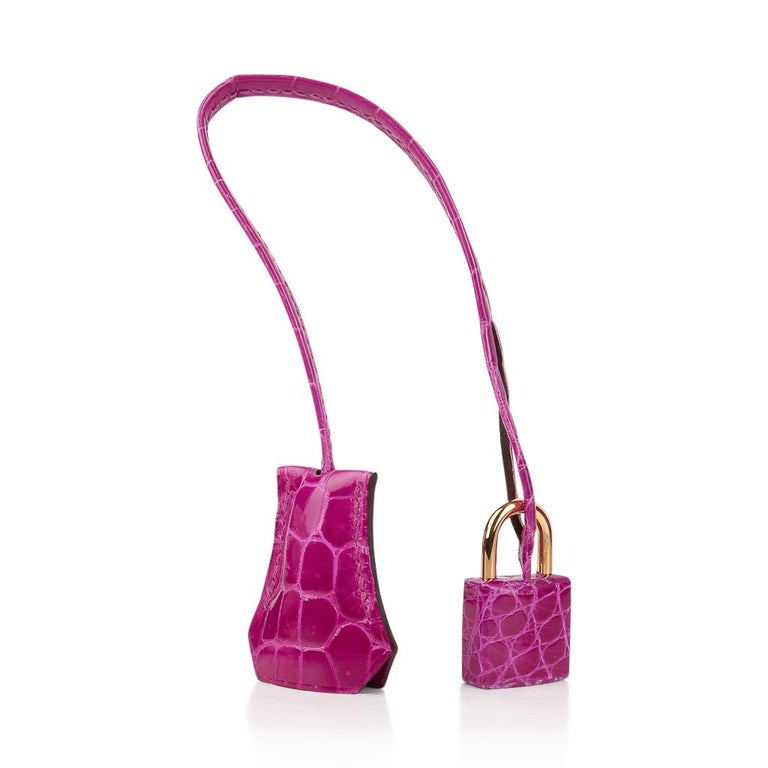 Guaranteed authentic Hermes Birkin 30 bag features vivid Rose Scheherazade Crocodile Lisse.  The most exquisite scales create this show stopping and over the top fabulous bag.  Accentuated with gold hardware.  This perfect jewel takes you from day