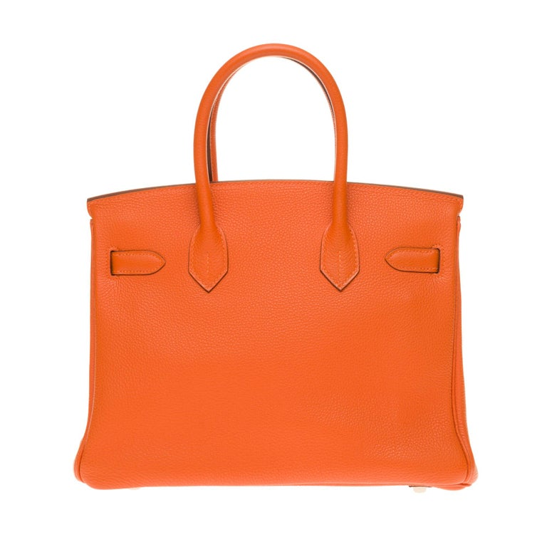 Exceptional Hermes Birkin handbag 30 cm in orange Togo leather, palladium metal hardware, orange stitching, double orange leather handle allowing a handheld  Closure by flap Orange leather inner lining, one zipped pocket, one patch pocket Sold with