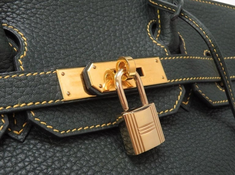 Leather Gold tone hardware Leather lining Turn lock closure  Made in France Date code present Handle drop 4.5