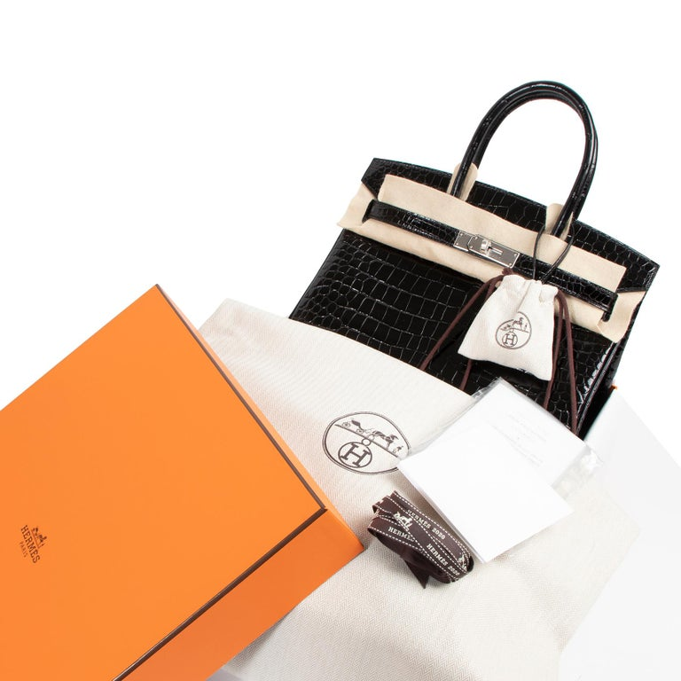 BRAND NEW / STOREFRESH  Hermès Birkin 30cm in color black and shiny Porosus Crocodile skin with palladium hardware. Though Hermès is known for its vast pantheon of incredible colors, there are a select few that have been the brand's mainstays for