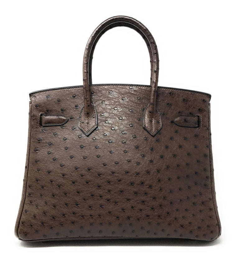 Better than chocolate! This 30cm dark Chocolate Brown Birkin is crafted in Ostrich skin which was discontinued by Hermes for a while making it an extremely hard to to get luxury item.  Pores are visible throughout the exterior creating a chic and