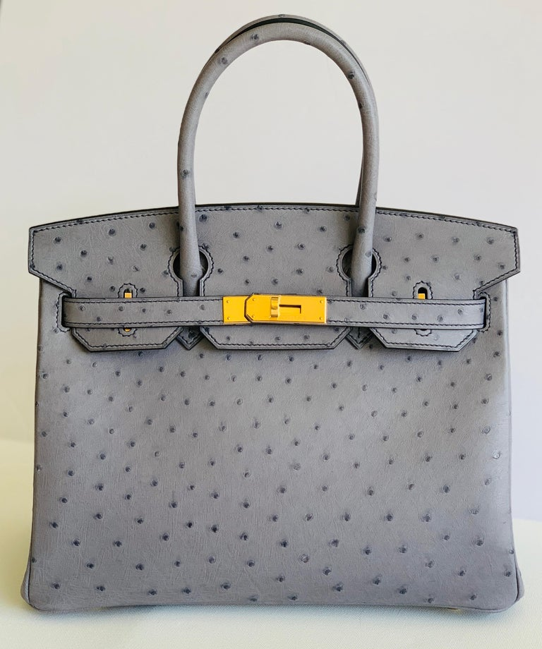 HERMÈS This is a Special Order Birkin, denoted by the Horseshoe Stamp Gris Agate Ostrich Contrast Blue Iris Stitching Blue Iris Chevre Lining Absolutely Gorgeous bag to add to any collection This bag took almost 2 years to get from date of