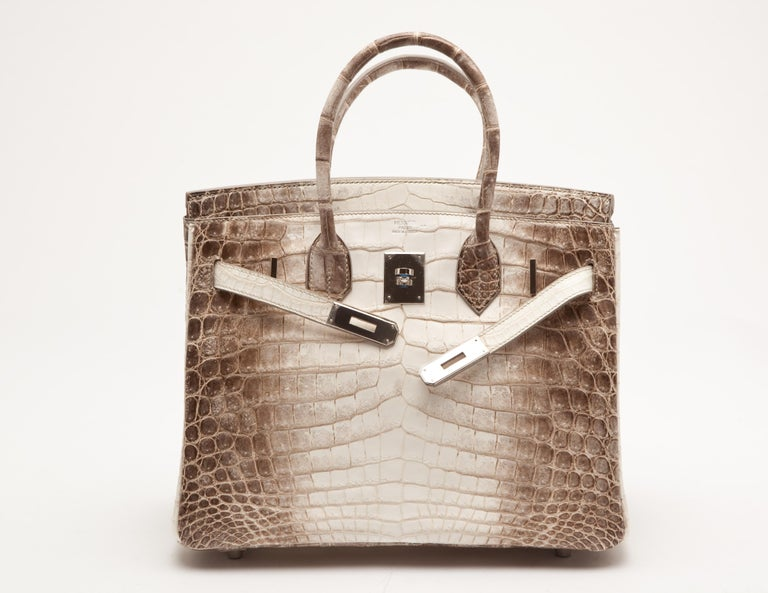 Hermes Birkin 30cm in classic hiamalayan niloticus crocodile leather with palladium hardware.  A classic since its inception, it is one of the world's most coveted handbags.   Packaged in its original packaging with all applicable CITES documents.