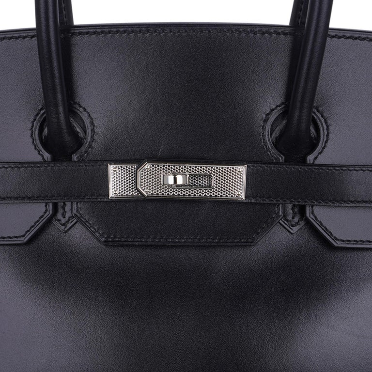 Mightychic offers a guaranteed Hermes Birkin 35 bag featured in Black rare Box leather. Beautiful with Palladium limited edition Guilloche Hardware. An extraordinary combination. Comes with lock, keys, clochette, sleeper, raincoat and signature