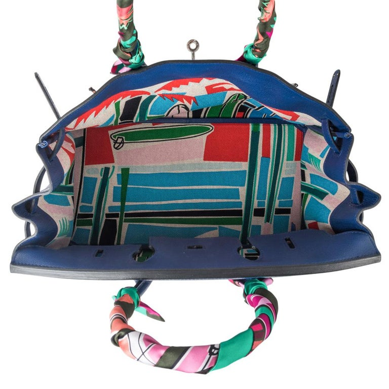 Guaranteed authentic very rare limited edition Hermes Birkin bag featured with interior toile is scarf print Sea Surf and Fun in blue red and pink colorway, designed by Filipe Jardim.   Blue Sapphire Taurillon Novillo leather accentuates the deep