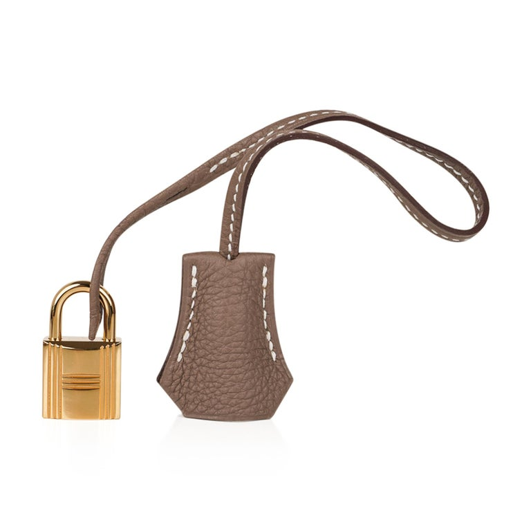 Mightychic offers a guaranteed authentic Hermes Birkin 35 bag featured in Etoupe. Luscious with rare to find gold hardware. Supple Togo is scratch resistant and butter soft to the touch. This stylish and sought after neutral color is the perfect