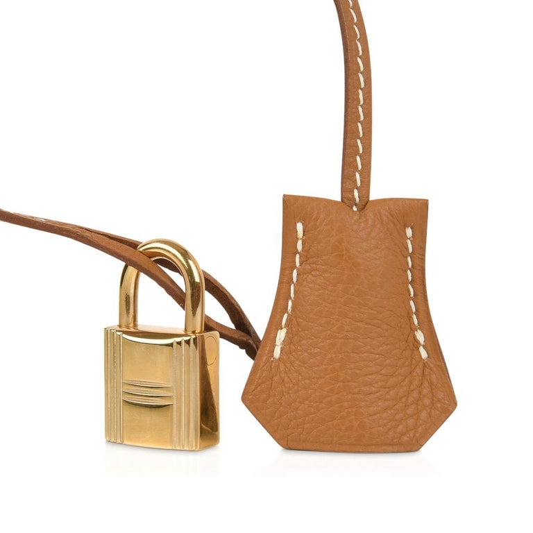 Guaranteed authentic Hermes 35 Birkin bag features in the iconic classic, Gold. Lush gold hardware and signature bone top stitch. The Togo leather has a beutiful even grain - and is highly scratch resistant. NEW or  NEVER WORN.  Comes with sleepers,