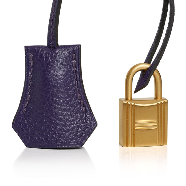 MIghtychic offers a guaranteed authentic Hermes Birkin 35 HSS bag featured in vivid Iris with Electric Blue piping and interior.  This exotic special order Birkin bag has the zipper pocket on interior front wall. This Hermes Birkin is rich with