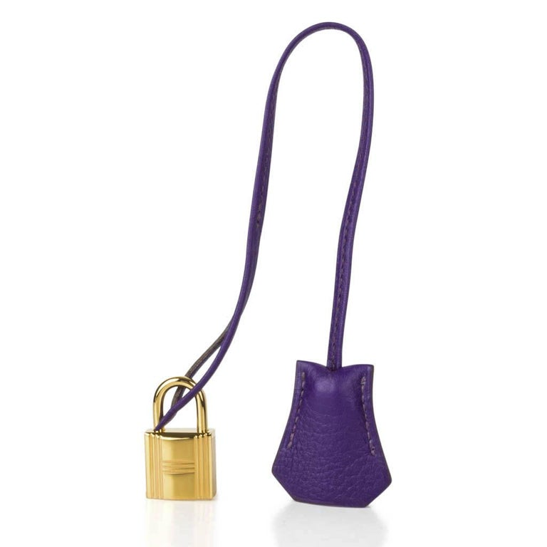 Guaranteed authentic Hermes Birkin 35 HSS bag features  vivid purple jewel toned Iris. Special Order Horseshoe with muted pink Boise de Rose interior. This exotic combination is accentuated with lush gold hardware. Clemence leather is scratch