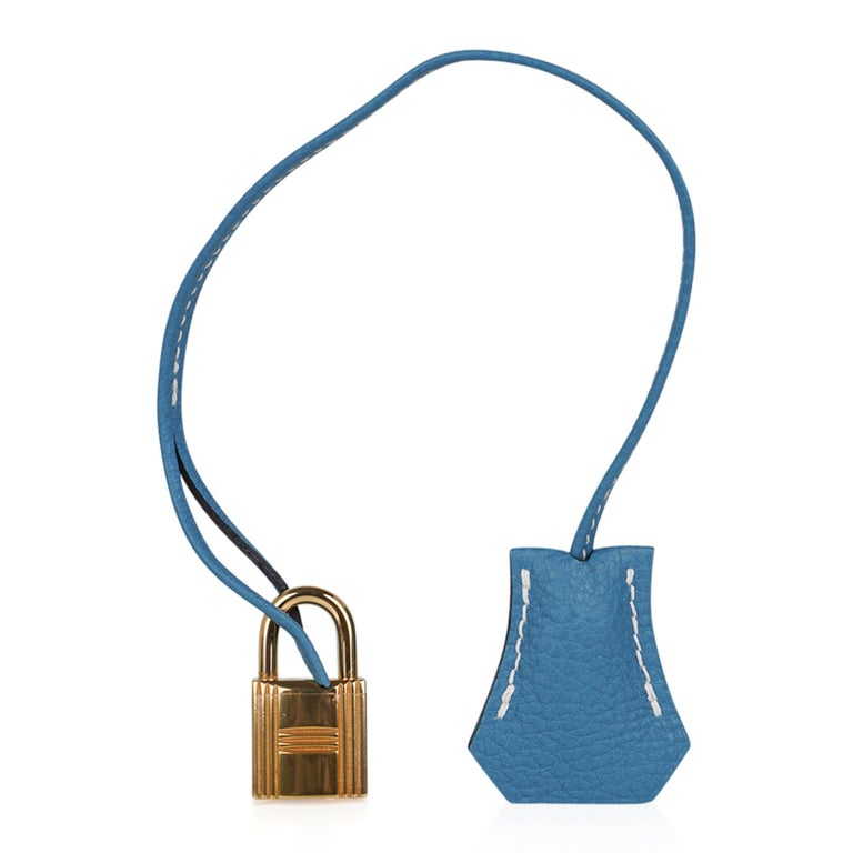 Guaranteed authentic Hermes Birkin 35 bag featured in iconic Blue Jean with signature bone top stitch. No longer produced, this gorgeous bag is a great find!  Accentuated with gold hardware. Togo leather is scratch resistant.   Comes with lock,