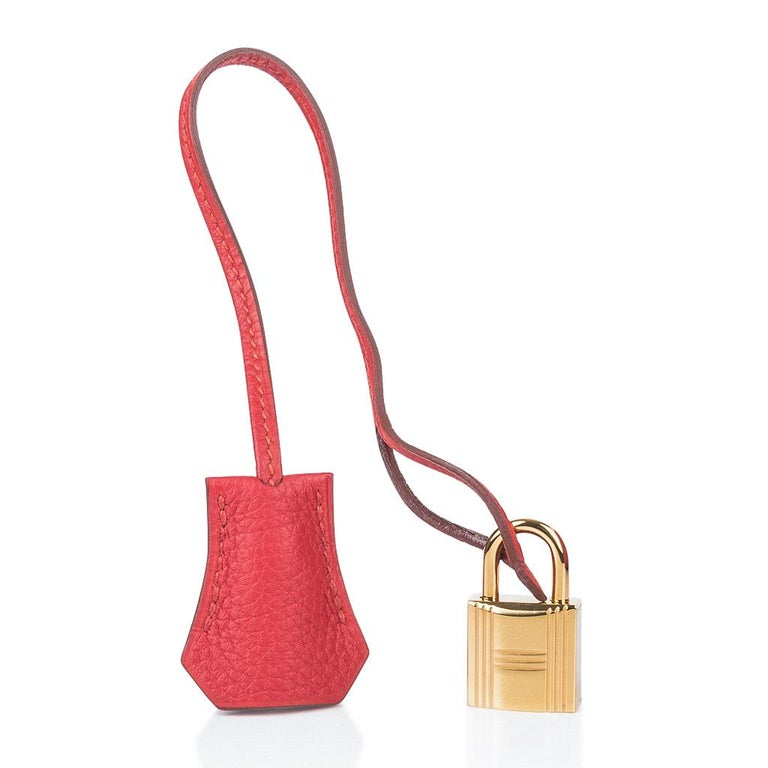 Guaranteed authentic Vermillion red Hermes 35 Birkin bag. Unique warm red tone - is lush with gold hardware. Togo leather is scratch resistant. NEW or NEVER WORN.  Comes with lock, keys, clochette, sleepers, raincoat and signature Hermes box with