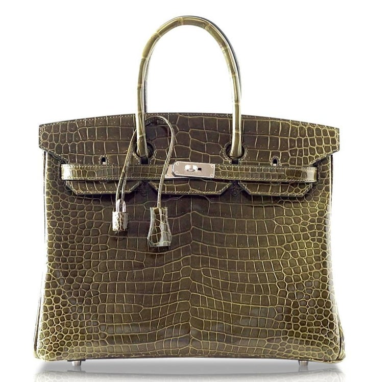 Rare Hermes Vert Veronese army toned green makes the perfect year round colour and is utterly neutral.  In exquisite Porosus Crocodile which is the small scale and the most exclusive. Fresh with palladium hardware. NEW or NEVER WORN.  Comes with