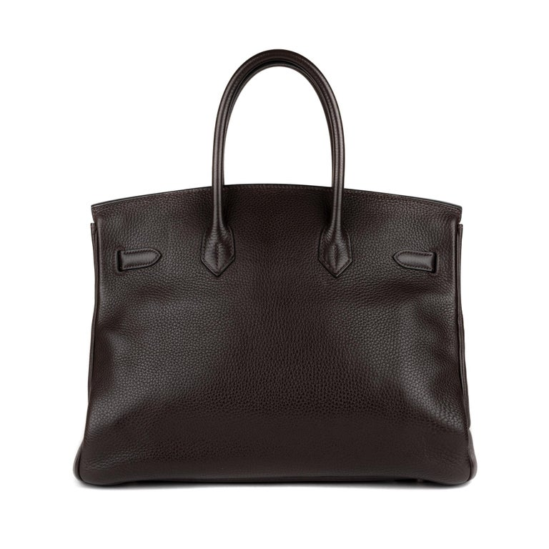 Brand: Hermès Type: Birkin 35 Leather  type: Togo  Color: Two Color  Ebony / Parma  Description: Hermes Birkin handbag 35 cm in ebony togo leather (outside) & Parma (inside), palladium metal trim, double black leather handle allowing a hand carried.