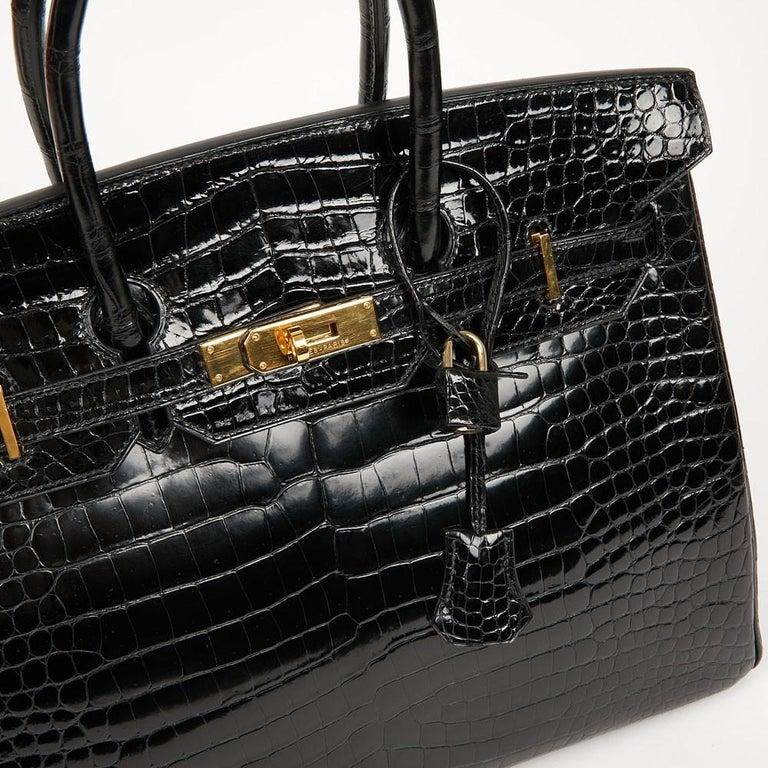 Hermes Birkin 35 Black Crocodile Bag And Golden Jewelry For Sale 7