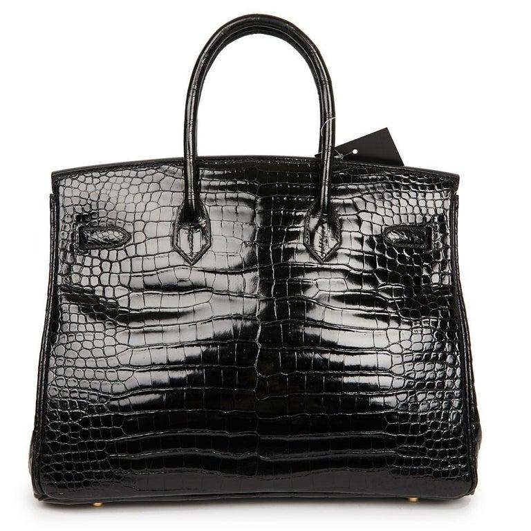 Hermes Birkin 35 Black Crocodile Bag And Golden Jewelry For Sale 3