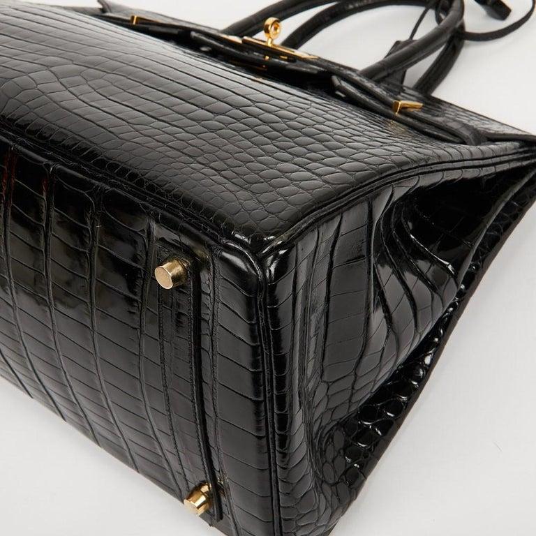 Hermes Birkin 35 Black Crocodile Bag And Golden Jewelry For Sale 4