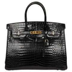 Hermes Birkin 35 Black Crocodile Bag And Golden Jewelry