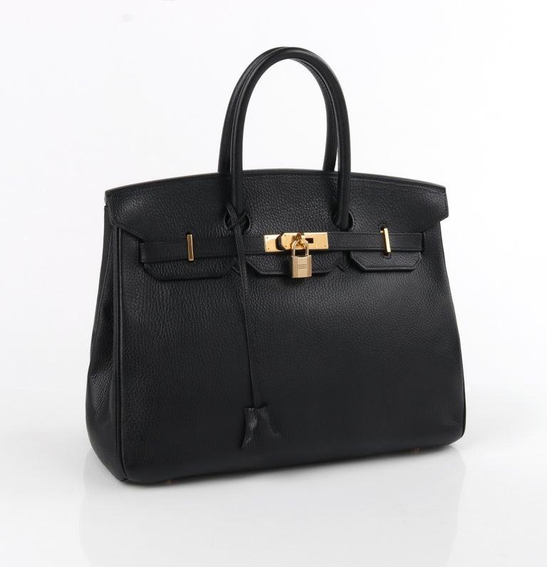 "HERMES Birkin 35 Black Fjord Leather Gold Hardware Twist Lock Top Handle Handbag   Brand/Manufacturer: Hermes Circa: 1998 Style: ""Birkin"" Handbag Color(s): Black Lined: No Unmarked Fabric Content: leather; metal (hardware) Additional Details /"