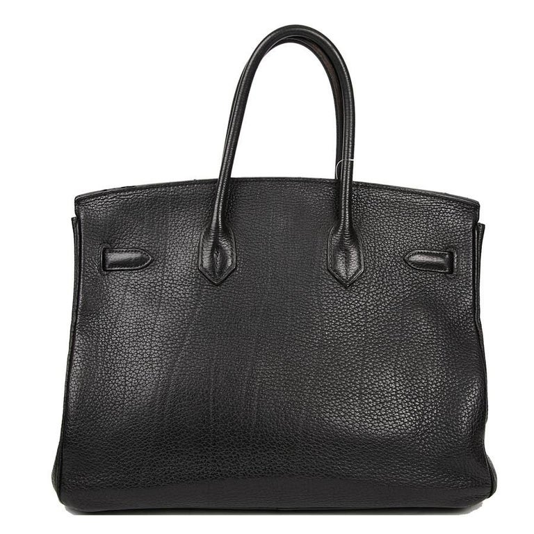 HERMES Birkin 35 black Togo leather bag. The jewelry is in silver metal. The bag is in very good condition. Made in France. Dimensions: 35 x 28 x 18 cm. Stamp M in a Square (2009 year).  Its zipper, bell, keys (2) and padlock are present.  Will be