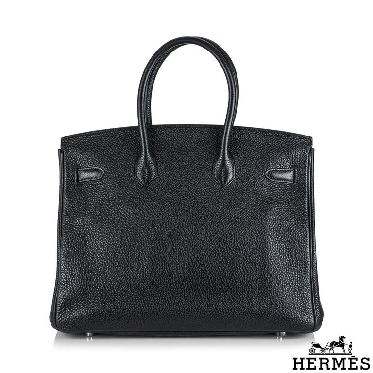 An exquisite Hermès 35 cm Birkin bag. The exterior of this Birkin features togo leather in black and is detailed with palladium hardware. The exterior of this Birkin has tonal stitching, two straps with a front toggle closure. The interior features