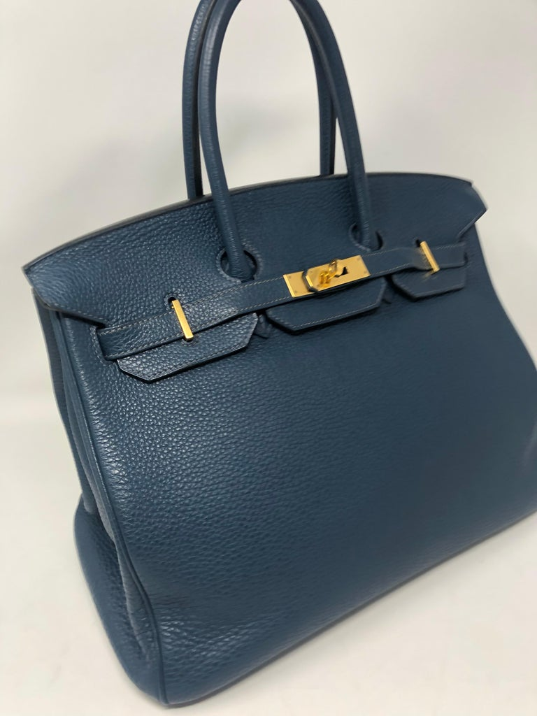 Hermes Birkin Blue De Malte Togo Leather Bag. Gold hardware. Size 35. Classic size. Beautiful sapphire blue color. Rare color and good condition. Stamp N square. From 2010. No corner wear. Neutral blue color will go with almost anything. Guaranteed