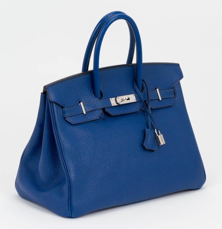 Hermès Birkin 35 cm preowned in blue de France togo leather and silver tone hardware. Very good condition, except for a few scratches on metal plates and loose turn lock. Handle drop, 4
