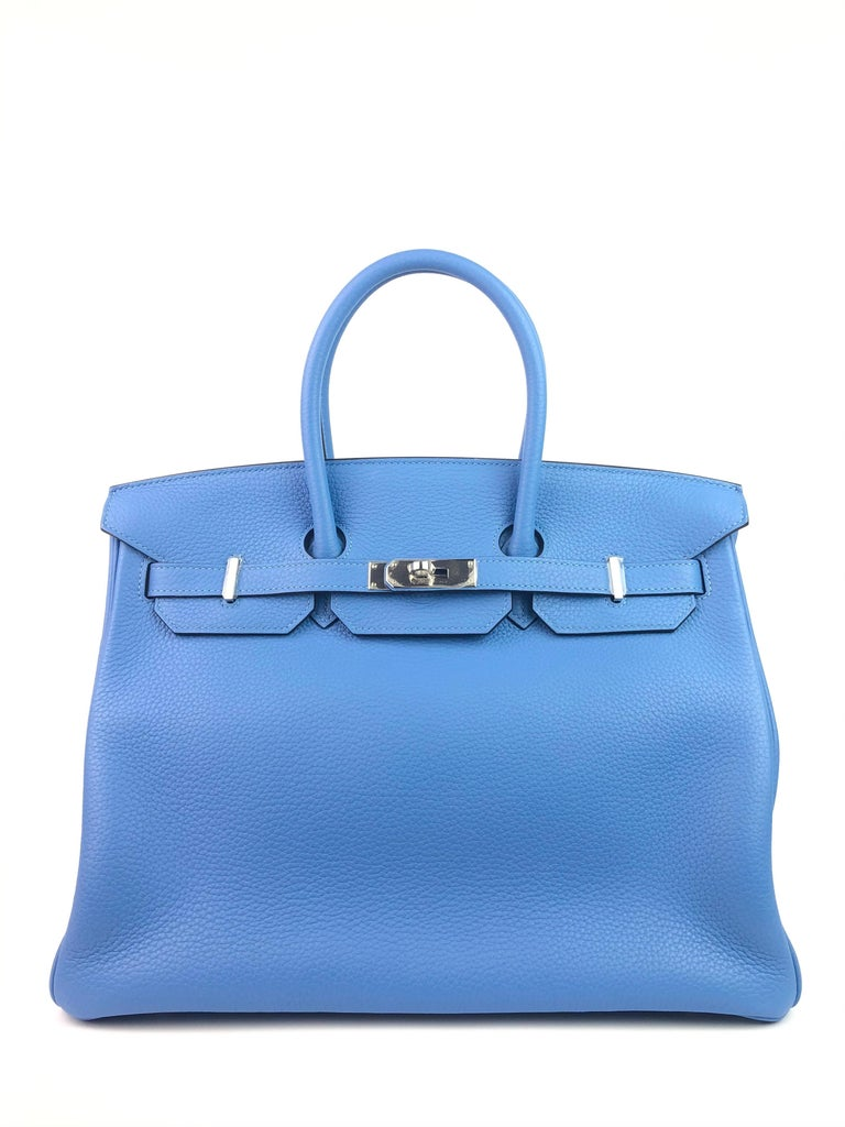 RARE HERMES BIRKIN 35 BLUE PARADISE PALLADIUM  HARDWARE. Almost Like New with all Plastic on hardware and feet excellent corners and structure. R Stamp 2014.  Shop with Confidence from Lux Addicts. Authenticity Guaranteed!